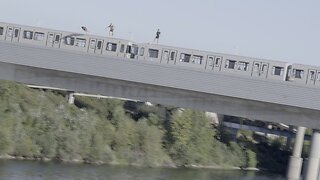 SHOCKING MOMENT DAREDEVILS JUMP FROM MOVING TRAIN INTO RIVER