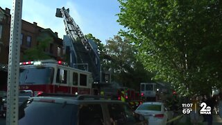 Two-alarm fire damages three row homes in Baltimore City