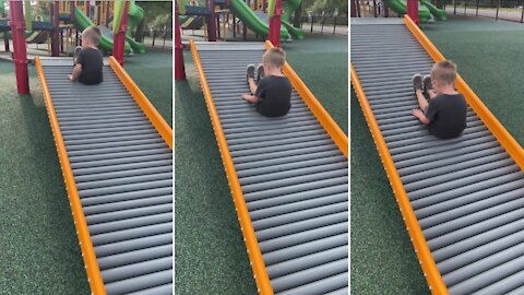 Kid makes funny sound going down the slide