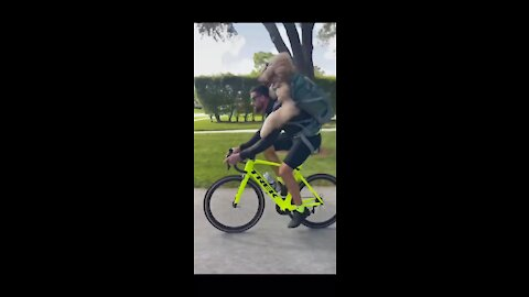 Funny video dog cycling with his friend
