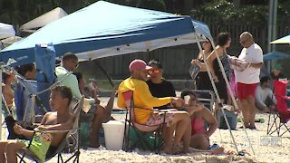 Families celebrate Labor Day weekend at beach despite COVID-19 concerns