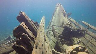 Scuba divers explore an eerie shipwreck in Devil Island Channel