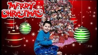 Christmas Morning: Noah Opening Presents
