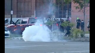 Protesters clash with Detroit police as curfew goes into effect Sunday night