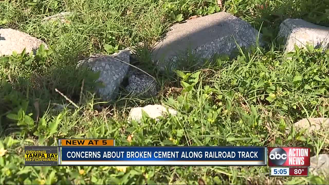 Concerns about broken cement along railroad track