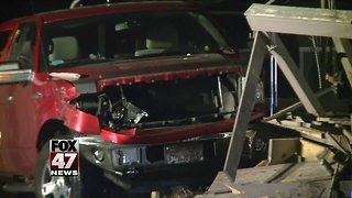 Man hurt after crashing truck into home