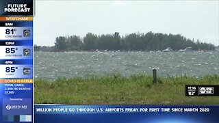 Man missing after attempting to save two swimmers