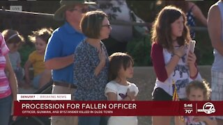 People line Arvada streets in procession for fallen Arvada police officer