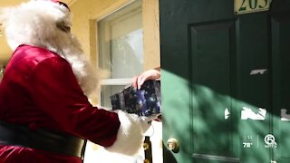 Kids in Riviera Beach receive gifts from Santa Claus