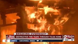 Destructive fire tears through Tulsa home