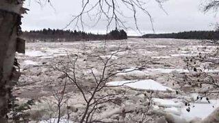 Arctic ice flows through Canadian river
