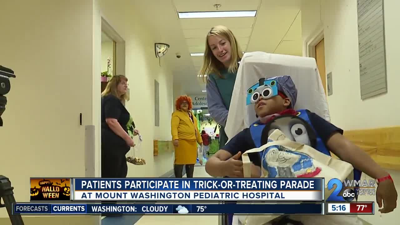 Patients participate in trick-or-treating parade in Mount Washington