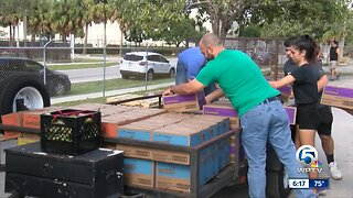 Volunteers help move thousands of Girl Scout cookies to local troops
