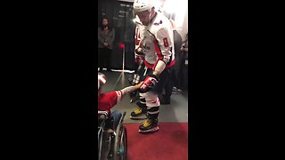 Ovechkin gives his stick to young fan in wheelchair