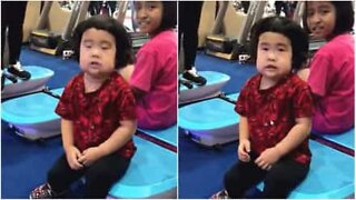 Little girl can't get enough of a vibrating exercise board!