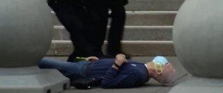 Police suspended after elderly man is shoved