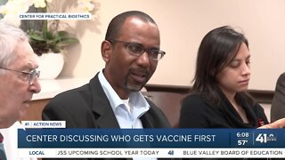 Center discussing who gets vaccine first