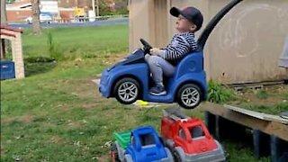 Kid pulls daredevil stunt with dad's help