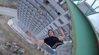 Watch the heart stopping moment daredevil hangs off crane