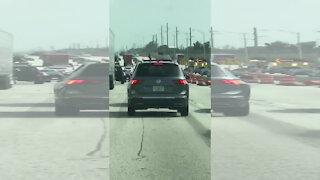 Cellphone video shows driver waving gun through sunroof on I-95