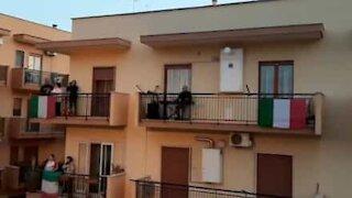 Quarantined residents Italian neighborhood jointly sing national anthem