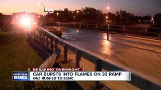 One rushed to hospital after fiery crash on 33 overpass