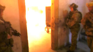 Special Forces breach their way thru