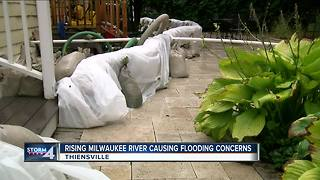 Thiensville businesses rush to stop Milwaukee River flooding