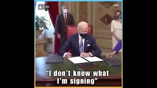 Joe Biden doesn't know what he's signing, signs anyways