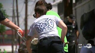 Denver police volunteer with other agencies to serve a crime-ridden southwest Denver community