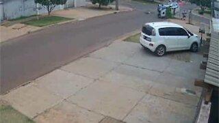 Pedestrian cheats death in police car near miss