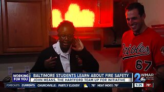 John Means helps students learn about fire safety