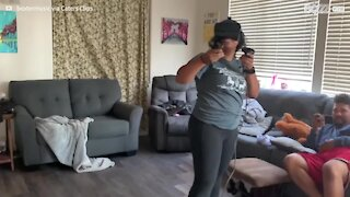 Woman hits TV during VR game 2