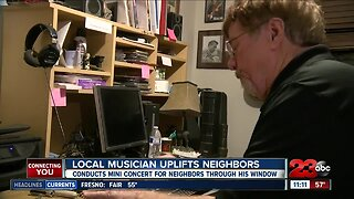 Local Musician uplifts neighbors with mini concert through his window