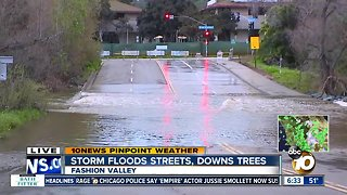 Rain leads to street near Fashion Valley