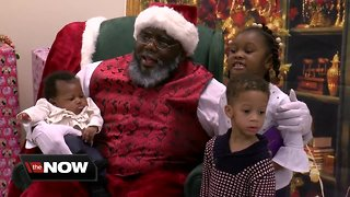 Diverse Santa Claus posing for pictures across Wisconsin