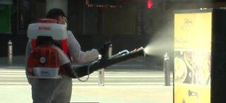 Crews begin fogging Fremont Street in Las Vegas