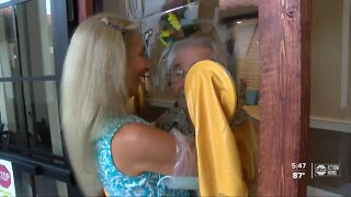 Seniors, families hug for first time in months