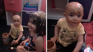 DRIVING MUM NUTTY: NAUGHTY TODDLER COVERS HER SISTER AND HERSELF IN PEANUT BUTTER