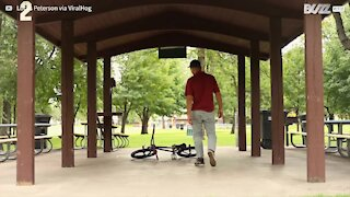 Guy pulls off outstanding bicycle stunt