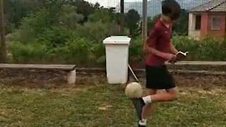 Youngster casually flicks football in garbage bin with amazing trick shot
