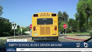 Empty San Diego Unified school buses driving around