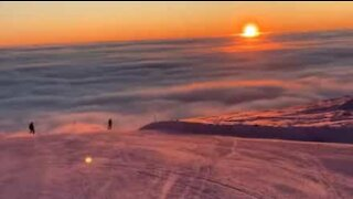 This is what snowboarding above the clouds looks like