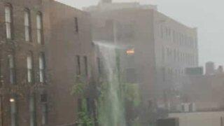 Storm creates huge waterfall on building