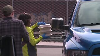 Denver group provides drive-up family meal for newly unemployed restaurant workers