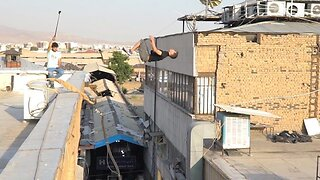Daredevil Performs Death-defying Backflip From One Rooftop To Another Building