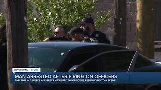 Man arrested after firing on officers