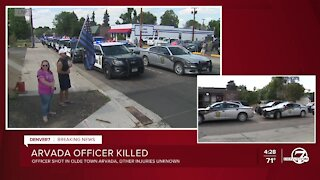 Police vehicles from across Colorado arrive for procession for fallen Arvada officer