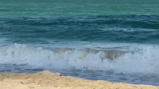 Waves of Dubai Beach Green and Blue water