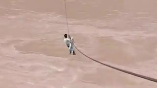 Crossing the river through rope